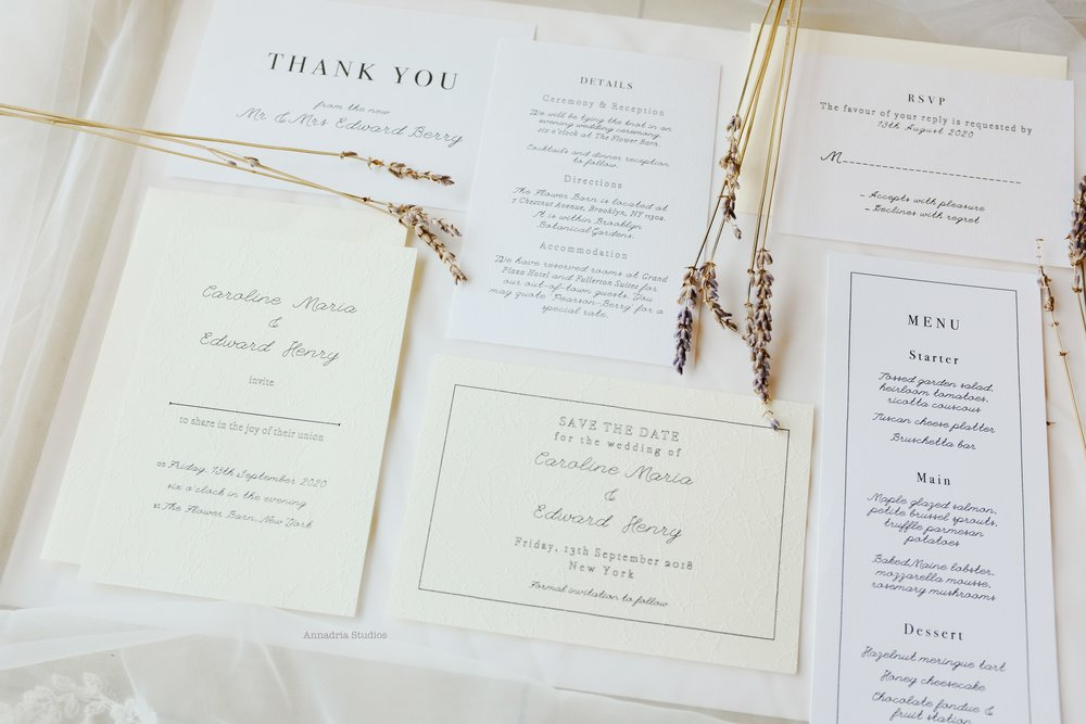 My invitation designs printed on a mix of luxurious embossed dye wax and cotton cardstock.