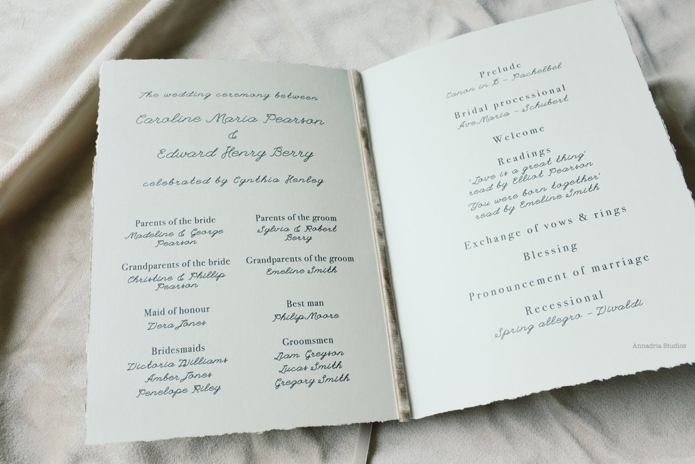 Beautiful handmade deckle edge ceremony program booklet, bound with bronze velvet ribbon.