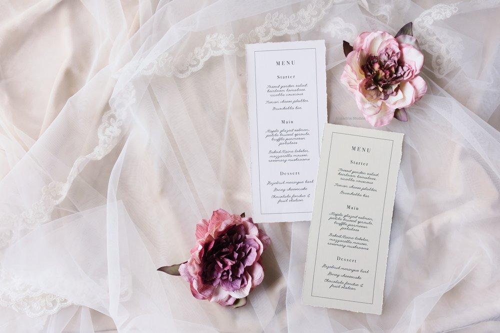 Deckle edge linen menu cards, exquisitely designed with hand-torn edges.